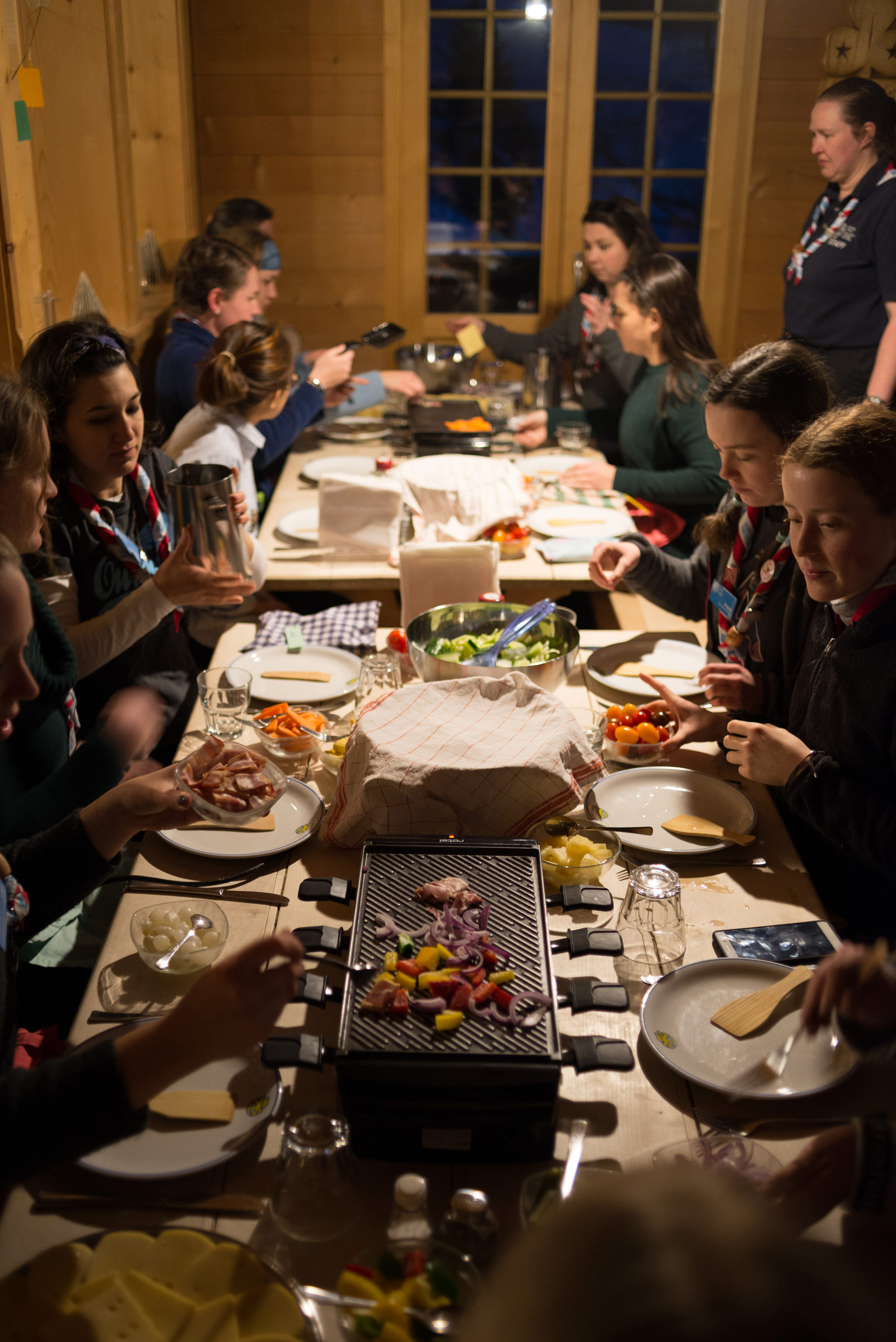 staff at our chalet eating raclette for dinner