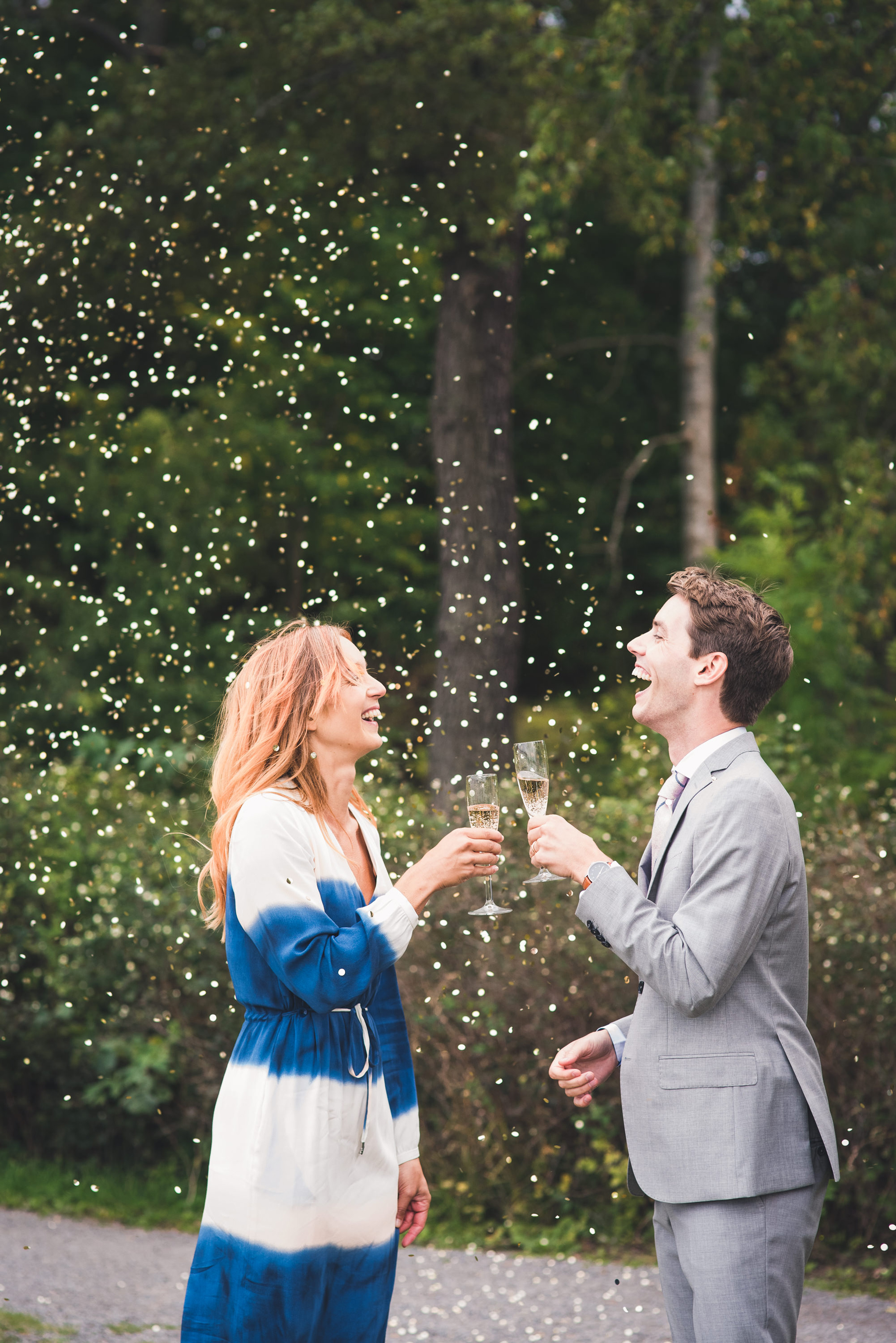 bride and groom making a toast in a cloud of glitter confetti